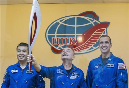 Russian cosmonauts will take the Olympic Torch for space walk